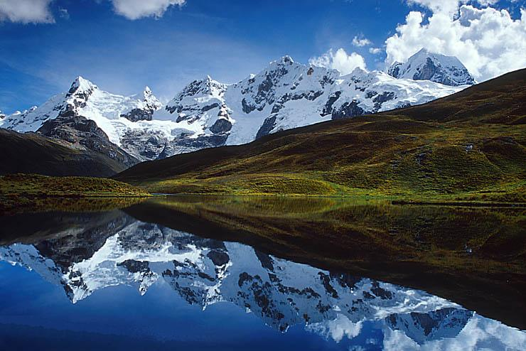 Cordillera Huayhuash reflected in lake at 15,000 feet, Peru
